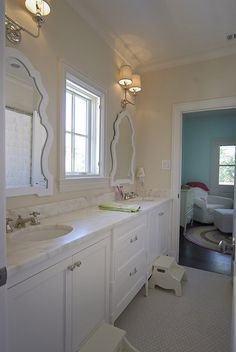 Jack and Jill bathroom by English Heritage Homes of Texas, so cute