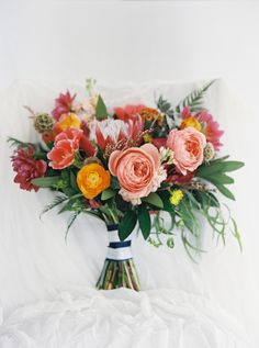 Flowers by Lace and Lilies - Boulder Colorado Wedding, colorful bouquet.  Coral garden rose, king protea, dahlia, ranunculus