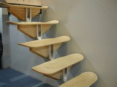 Stairs made of Skateboards. See the aluminum beam and fittings. I would probably not use skate boards, but the idea is practical.