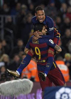 Barcelona's Uruguayan forward Luis Suarez (L) celebrates with Barcelona's Brazilian forward Neymar after scoring during the Spanish league football match FC Barcelona vs Athletic Club Bilbao at the Camp Nou stadium in Barcelona on January 17, 2016.