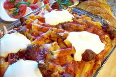 Ziti Al Forno (From the Sopranos Family Cookbook) from Food.com:   It's from the sopranos cookbook but I use my own Sunday Gravy (Real Italian Spaghetti Sauce)and Meatballs and it is the best food in the world there aren't words to describe it!