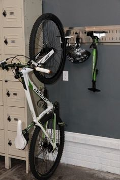 1 Bike Deluxe - Raise your gear in style!  Get your bike, helmet, and pump off the floor, love this system! #raiseyourgear