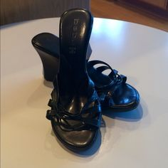 Bebe strap wedge sandals. Gently worn Bebe black wedge sandals. Women's size 10. Some mild scuffing on wedges and a couple of small discolorations on insole of left shoe.  Wedge measures 3 1/4in. bebe Shoes Wedges