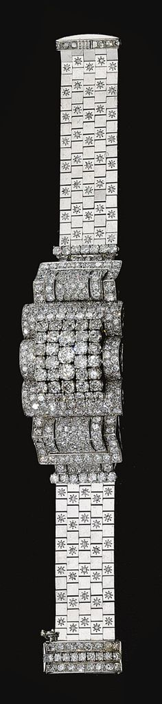 DIAMOND BRACELET, 'LUDO', VAN CLEEF & ARPELS,  1941.  The pont-type central curved plaque of stylised buckle design set with circular-, single- and brilliant-cut diamonds, the articulated briquette straps of flat square linking accented with single-cut stones, to a sliding clasp, mounted in platinum, signed Van Cleef & Arpels N.Y. and numbered, two small diamonds deficient.   length approximately 180mm  93.1
