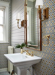 A powder room wallpapered in Hexagon by David Hicks. Photo courtesy of Amie Corley Interiors