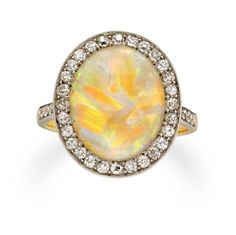 An Edwardian opal and diamond cluster ring