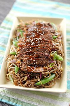 Teriyaki Steak Soba: Fried Soba Noodles with sesame oil, red onions, spring onions, bean sprouts, sugar snap peas and chili topped with Grilled Beef Tenderloin Slices marinated in Teriyaki Sauce