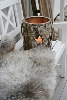 Sheepskin as a cosy cover for a seat or bench outdoors. Via Vibeke Design
