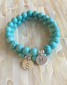 Chunky bead bracelet accented with a sterling silver charm hand stamped with your choice of initial looks great on its own or layered. Threaded