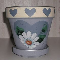 Hand Painted Flower Pots can be as simple or as elaborate as you wish. Here is a collection of some of the most beautiful hand painted pots around. Flower Pot Art, Flower Pot Design, Clay Flower Pots, Terracotta Flower Pots, Flower Pot Crafts, Clay Pots, Painted Plant Pots, Painted Flower Pots, Clay Pot Projects