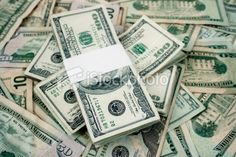 Hundred dollar bills stacked and with money background