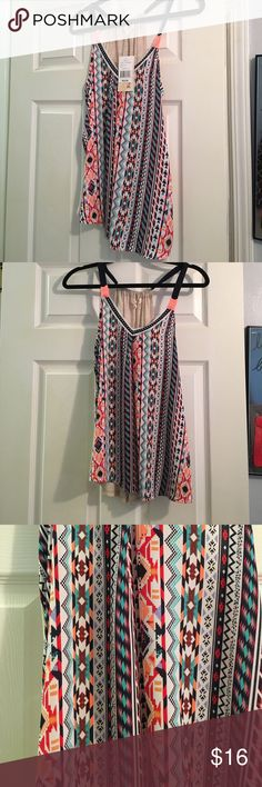 Rewind Aztec print tank top size S Rewind brand from bealls in Aztec print size small. Super cute and flowy! This tank top to me is more junior style and that is why I never wore it. Two different materials, one in front and cotton in the back, see photos! Offers welcomed! 😊 Rewind Tops Tank Tops