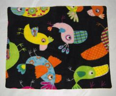 This cute birds lap pad is meant for bonding time with your pet! Made from soft fleece it is sure to make the experience enjoyable for all!  Approx. Size W x L: 38 x 46 cm (15 x 18 inches)  This is made for pet owners, by pet owners in a smoke free home! The patterns may vary slightly depending on the print size! Machine washable/Dryer safe on low  NOTE I will refund any shipping overages on applicable orders!  If you would like a custom design or size on any of my items, please feel free…