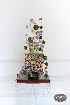 25 Incredibly Beautiful Wedding Cakes That Won 2015: #24. This intricate, stained glass-inspired cake.