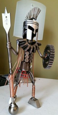 Spartan king Leonidas 300 scrap metal art piston head. Welded from reclaimed engine parts and other scrap metal.