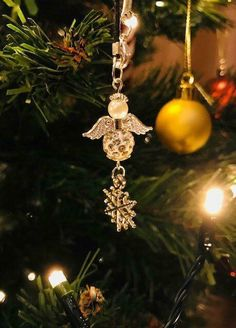A handmade Christmas angel with a snowflake charm. Handmade Christmas, Christmas Gifts, Christmas Ornaments, Christmas Angels, Snowflakes, Handmade Jewelry, Gift Ideas, Holiday Decor, Holiday Gifts