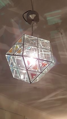 Made with a mix of clear squares and dichroic triangles. Not in our catalogue, please contact us for more information. Broken Glass Art, Sea Glass Art, Mosaic Glass, Fused Glass, Geometric Pendant Light, Glass Pendant Light, Glass Pendants, Stained Glass Designs, Stained Glass Patterns
