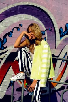 neon yellow jacket and striped trousers