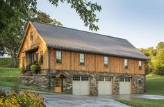 I absolutely want and love this! Barn Home with stone around the 3 car garage. Sand Creek Post & Beam Wood Barn & Barn Home Kits