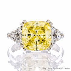 One of our most popular settings is this cushion cut canary 5A CZ engagement ring set in Sterling Silver, 10 or 14 karat white or yellow gold! Starting at $145 ❤️ MY FAUX DIAMOND http://evpo.st/1JpKaUV