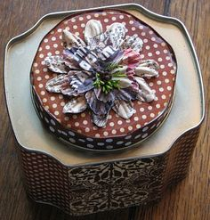 Altered tea tin with BoBunny papers . . .