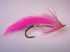 Fly Tying: Ontario Driftboat Guides - Fly fishing guide and drift boat trips for trout, steelhead salmon, smallmouth, muskie, pike and carp on Southern Ontario rivers.
