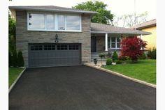 grey garage and front doors