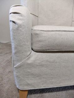 Cotton and linen slipcover with a short skirt and soft pleats.