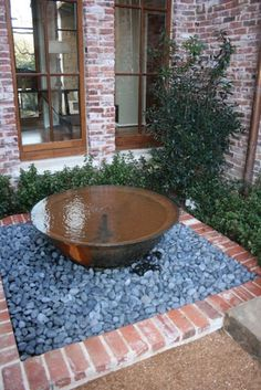 New orleans syle courtyard with sugar kettle fountain for Landscaping rocks new orleans