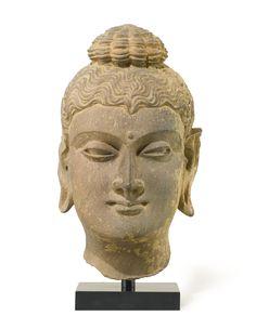 A Grey Schist Head of Buddha Height: 9 1/4 in. (23.5 cm) Ancient region of Gandhara, Kushan period, 3rd/4th century