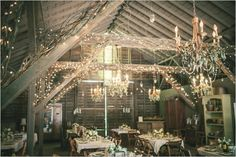 Our venue is far from this rustic, but I LOVE all the lighting and the greenery on the chandelier!
