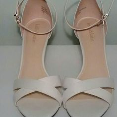NWOT Ankle Strap Pumps Brand new and never worn. Kelly & Katie strappy pumps in a beautiful cream/white color. No tags but these are new! Size 9 with a 3 inch heel. Gorgeous! Kelly & Katie Shoes Heels
