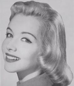 1950s Pageboy hairstyle.....my mom wore her hair like this for years and she looked like this model