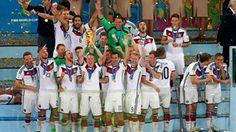 Bastian Schweinsteiger of Germany raises the World Cup trophy in celebration