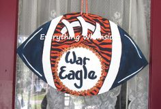 Hand painted tiger stripes are the focal point for this wooden Auburn door hanger!
