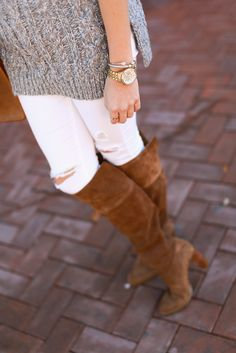 ripped white jeans and tan suede over the knee boots