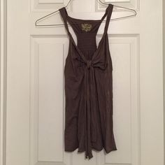 """☀️ Free People tank with tied front Free People brown racerback tank with bow feature on the front and twisted shoulder straps. 25"""" long and fits true to size. 60% cotton, 40% modal. Free People Tops Tank Tops"""