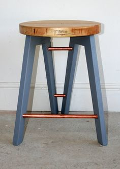 Hand crafted tripod stool with reclaimed wood and copper pipe detailing painted in a dusty grey blue. Seating, chair, stool