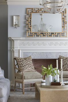 """It's """"Greek"""" to me...pillows & mantle millwork (Greek Key)... Frame It Right """"In this case, more is not necessarily better,"""" says Phoebe. """"The frame should finish off the piece, not compete with it."""" Most large works look good with a simple floater frame, but an unframed canvas or Lucite box would also be a good option."""