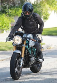Ducati Sport Classic 1000/Ryan Reynolds. yeah bro...Because it has two of my favorites, Ryan Reynolds AND the Ducati