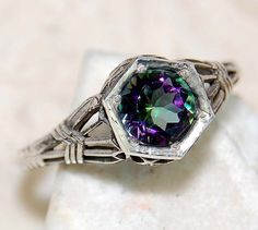 'Size 7.5 Mystic Topaz Sterling Silver Ring' is going up for auction at  9am Thu, Jul 12 with a starting bid of $10.