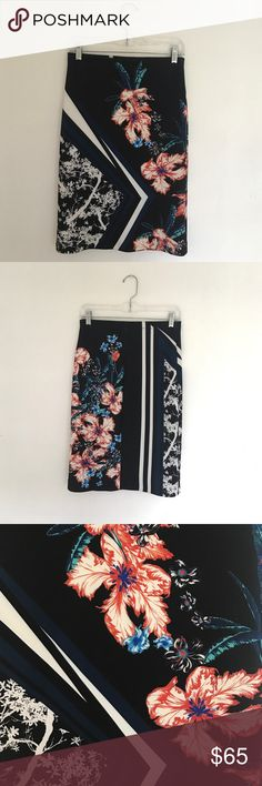 Clover Canyon Skirt Size Medium RN#91411 Navy knee length pencil skirt with flower and striped print. Size Medium. Great fit, hugs body, great for tucking in a button down blouse or casual tank or tee. Flattering fit. Rayon and spandex, similar to a thin wetsuit material. Originally $260 Clover Canyon Skirts Pencil