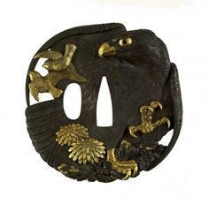 """Tsuba with a Hawk, Sparrows and Chrysanthemums""  Unno Moritoshi (Japanese, 1834-1896) & Unno Yoshimori (Japanese, 1864-1919). Shibuichi, gold & gilt detail."