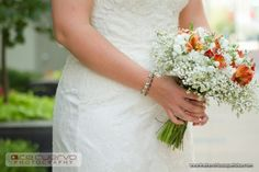 Baby's Breath with pops of color. You have to check out the entire blog. So Cute.
