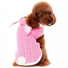 An adorable pink bunny cable knit sweater with detailed bunny ear hood and a pom-pom tail. Leash hole for convenience.