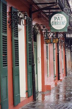 Pat O'Brien's Bar. Home of the hurricane cocktail - harmless till you try and stand up.
