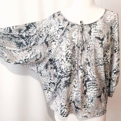 """Just In KENAR Blue & Grey Animal Print Blouse Striking blouse! Featuring scoop neckline, with keyhole detail and self tie. Pleated details on center front, full sleeves with elastic hem. Free flowing fit. 100% poly Machine washable 44"""" bust 26"""" overall length Kenar Tops Blouses"""