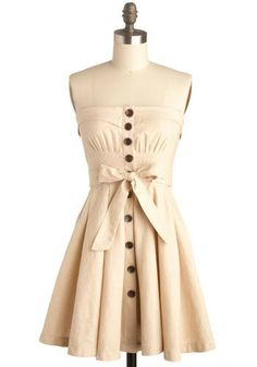 I love the cinched detail, the buttons, the bow