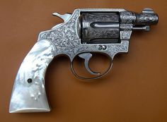 Factory engraved Colt Detective Special with pearl grips.