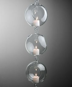 The Hanging Glass Terrarium showcases candles, air plants, moss or fresh flower blossoms, and complement simply decorated areas. This glass orb is wide and tall, with a glass hook on the bottom and on the top. Hanging Candles, Hanging Crystals, Glass Globe, Glass Candle, Hanging Glass Terrarium, Terrarium Containers, Terrariums, Save On Crafts, Miniature Plants